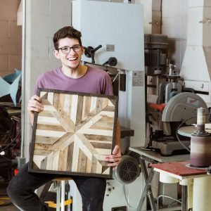 A CUAA student cultivates a talent for turning reclaimed wood into art