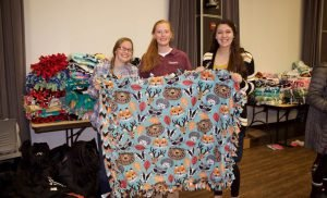 Concordians gift children with Operation Christmas Child boxes and blankets