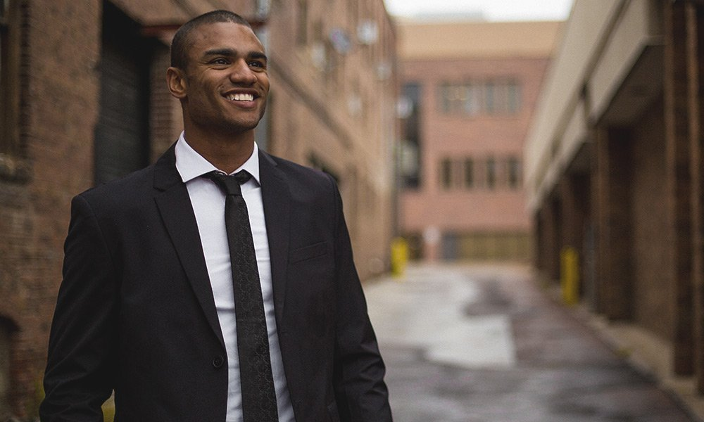 Man in a suit smiling confidently