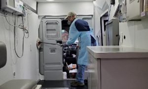 Stinson ('19) cleans out the medical van after caring for patients.